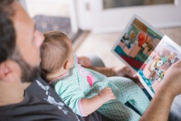 SPEECH PATHOLOGY: Father helping child to read
