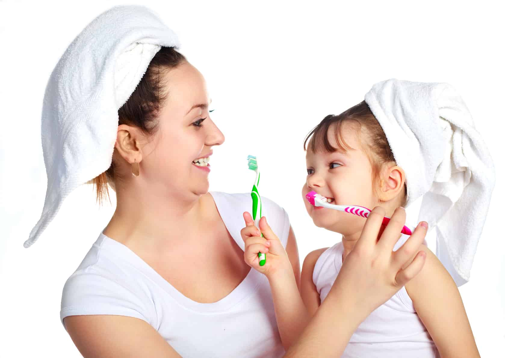 child behavior - Mother and daughter brushing their teeth laughing